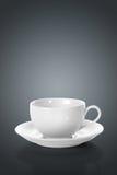 Taza de té vacía en gris Imagenes de archivo