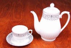 Taza de té y crisol del té Foto de archivo libre de regalías