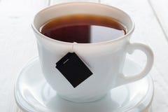 Taza de té y de bolsita de té Foto de archivo libre de regalías