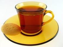Taza de té y de galleta Fotos de archivo