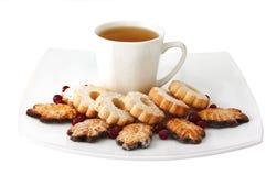 Taza de té y de galletas Fotografía de archivo