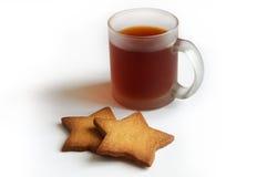 Taza de té y de galletas Foto de archivo libre de regalías
