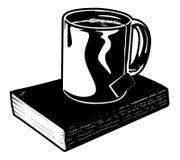 Taza de té y de libro Imagen de archivo libre de regalías