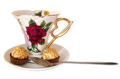 Taza de té y de sweeties. Imagen de archivo libre de regalías