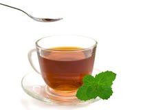 Taza de té y de una cuchara Imágenes de archivo libres de regalías