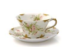 Taza de té y platillo antiguos Fotos de archivo