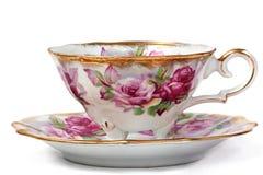 Taza de té y platillo antiguos Fotos de archivo libres de regalías