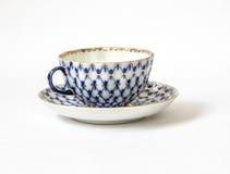 Taza de té y un platillo fotografía de archivo