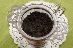 Taza de té y un tamiz del té Imágenes de archivo libres de regalías