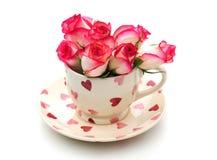 Taza de té con las rosas Imagenes de archivo