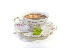 Taza de té en el alto té Imagen de archivo