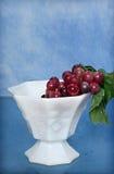 Taza de uvas Foto de archivo libre de regalías