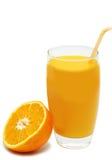 Taza de zumo de naranja con la naranja Fotos de archivo