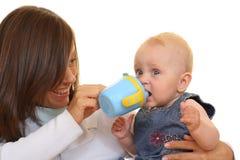 Taza del bebé Fotos de archivo libres de regalías