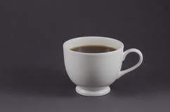Taza del café con leche con café sólo Foto de archivo