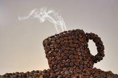 Taza del grano de café Imagen de archivo libre de regalías