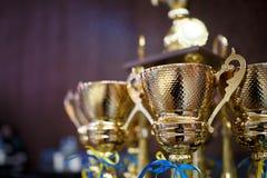 Taza del oro para el ganador 1ra recompensa del lugar Foto de archivo libre de regalías