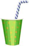 Taza del partido con la paja rayada Imagen de archivo