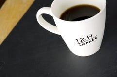 taza del trabajador 12h Fotos de archivo libres de regalías