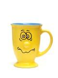 Taza divertida amarilla Foto de archivo libre de regalías