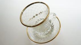 Taza en el platillo Imagen de archivo libre de regalías