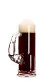 Taza estrecha de cerveza marrón. Imagen de archivo