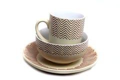 taza marrón en una placa Imagen de archivo