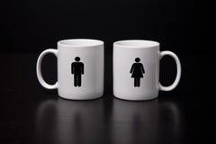 Taza masculina y femenina Imagenes de archivo