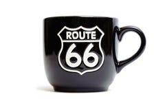 Taza negra de la ruta 66 Imagen de archivo