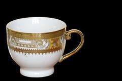 Taza plateada del diseñador del oro blanco aislada en negro Foto de archivo