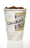 Taza por completo de cambio, universidad Imagen de archivo
