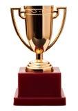 Taza premiada del oro en soporte fotografía de archivo libre de regalías