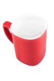 Taza roja aislada en el fondo blanco Fotos de archivo libres de regalías