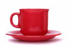 Taza roja con un sauser Foto de archivo libre de regalías