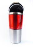 Taza roja de aluminio foto de archivo