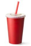 Taza roja de la cartulina con una paja Fotografía de archivo libre de regalías