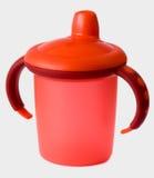 Taza roja del sip del bebé Fotografía de archivo libre de regalías