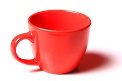 Taza roja plástica fotos de archivo libres de regalías