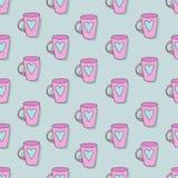 Taza rosada con una imagen del corazón Fotografía de archivo