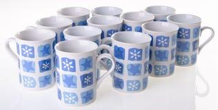 Taza, taza del color en fondo Foto de archivo libre de regalías