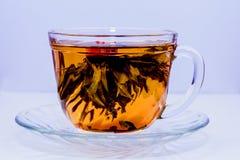 Una taza de té chino con la flor Fotografía de archivo libre de regalías