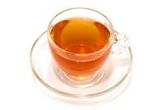 Taza transparente de té en un fondo blanco Fotografía de archivo libre de regalías