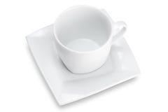 Taza vacía blanca con el platillo cuadrado, visión superior fotografía de archivo libre de regalías