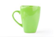 Taza verde aislada en un blanco Imágenes de archivo libres de regalías