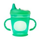 Taza verde del plástico del bebé. Fotografía de archivo libre de regalías