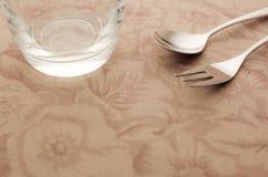 Taza y cuchara y fork Imagen de archivo libre de regalías