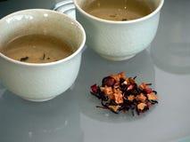 Taza y flores de té Fotografía de archivo