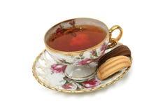 Taza y galletas antiguas de té foto de archivo