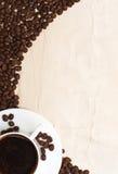 Taza y grano de café Imagen de archivo
