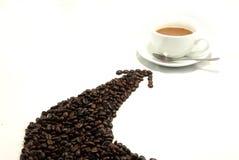 Taza y grano de café. Fotos de archivo libres de regalías